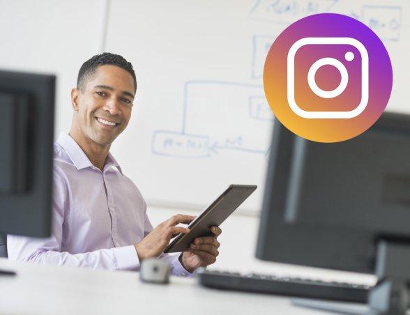 jnj_instagram101_2-stockimage_man-on-tablet-in-front-of-whiteboard-smile-pose.jpg